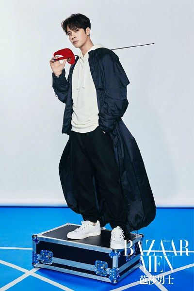 Tags: K-Pop, Got7, Jackson, Hoodie, Short Hair, Fencing, Hand In Pocket, Serious, Bag, Standing, Blue Outerwear, Shoes