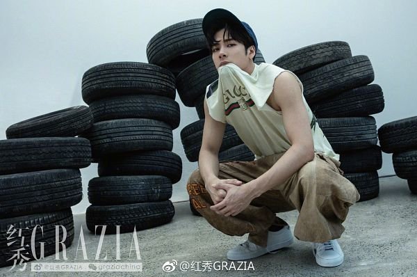 Tags: K-Pop, Got7, Jackson, Tank Top, Tire, Hat, Crouching, Bent Knees, Pants, Bare Shoulders, Text, Brown Pants