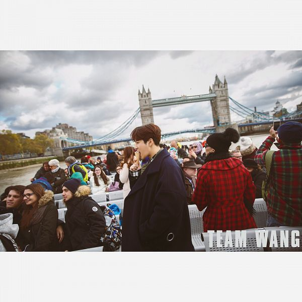 Tags: K-Pop, Got7, Jackson, Ice Cream, Hand In Pocket, Eating, Side View, Sweets, Hat, Blue Outerwear, Bridge