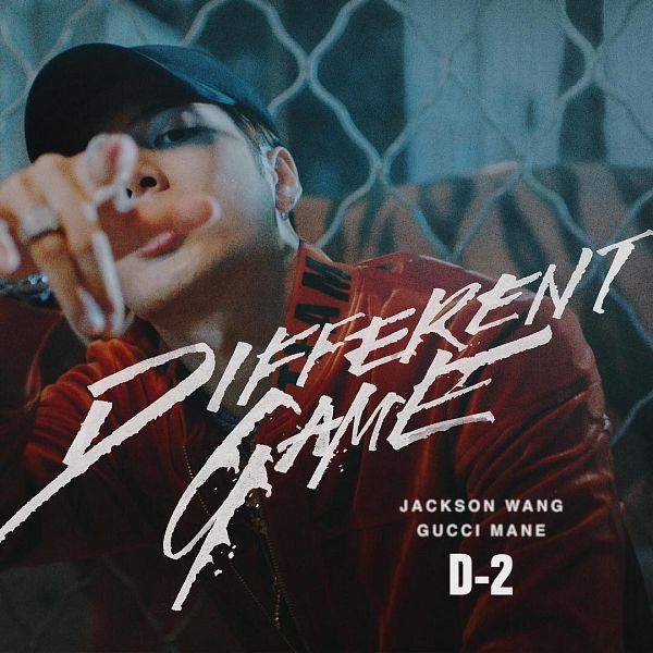 Tags: K-Pop, Got7, Different Game, Jackson, Hat, Serious, English Text, Red Jacket, Text: Song Title, Ring, Red Outerwear, Fence