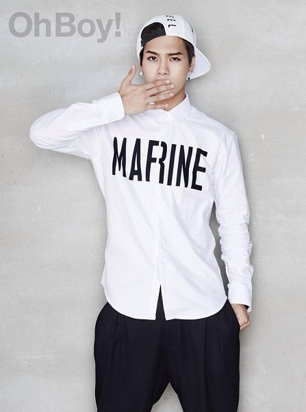 Tags: K-Pop, Got7, Jackson, Gray Background, Covering Mouth, Baseball Cap, Text: Magazine Name, Black Pants, White Headwear, Hand In Pocket, Hat, Magazine Scan