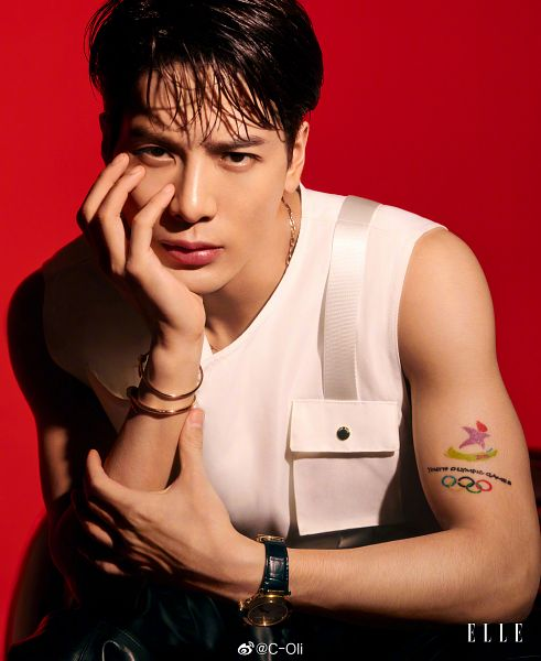Tags: K-Pop, Got7, Jackson, Serious, Red Background, Tattoo, Black Pants, Necklace, Arm Support, Bracelet, Elle Singapore, Magazine Scan