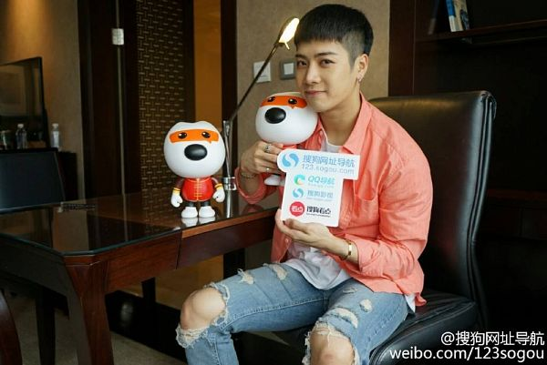 Tags: K-Pop, Got7, Jackson, Bookshelf, Chair, Toy, Table, Chinese Text, Sitting On Chair, Lamp, Book, Jeans