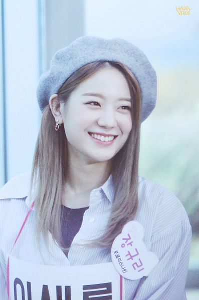 Tags: K-Pop, fromis 9, Jang Gyuri, Gray Headwear, Striped Shirt, Text: Artist Name, Looking Away, Striped, Hat, Korean Text, Happy Virus