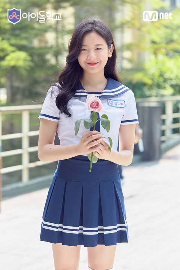 Tags: K-Pop, Television Show, fromis 9, Jang Gyuri, Pleated Skirt, Uniform, Blue Skirt, Skirt, Pink Flower, Flower, School Uniform, Idol School