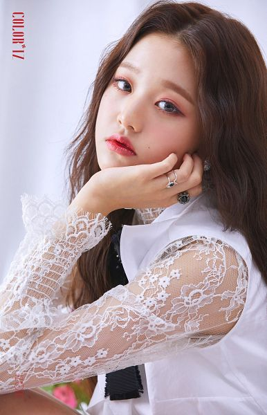 Tags: K-Pop, IZ*ONE, Jang Wonyoung, Red Lips, Facial Mark, Serious, Hand On Cheek, Hand On Head, Ring, Mole, Lace