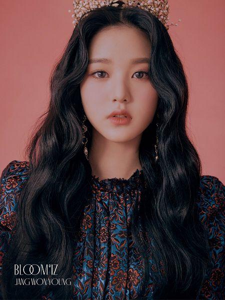 Tags: K-Pop, IZ*ONE, Jang Wonyoung, Black Eyes, Text: Artist Name, Text: Album Name, Headdress, Serious, Crown, Pink Background