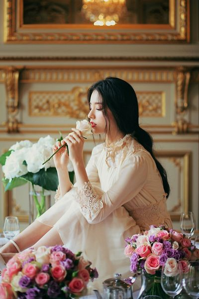 Tags: K-Pop, LOOΠΔ, ViVid, Jeon Heejin, Yellow Flower, White Outfit, Sitting On Table, Red Lips, Ring, Glass (Cup), Rose (flower), White Dress