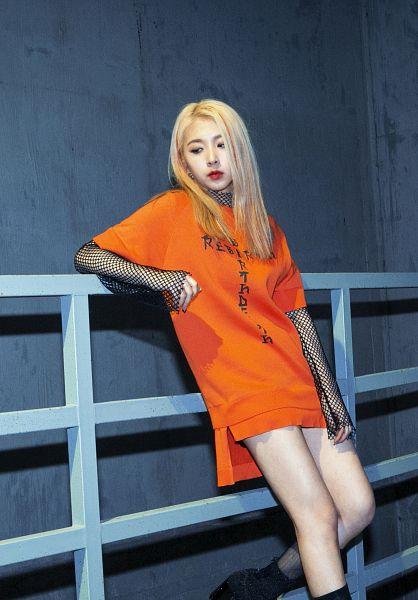 Tags: DSP Media, K-Pop, K.A.R.D, Rumor, Jeon Jiwoo, Orange Dress, Black Footwear, Red Lips, Orange Outfit, Gray Background, Leaning Back, Looking Down