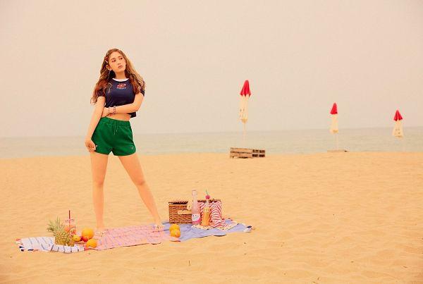 Tags: K-Pop, Jeon Somi, Water, Beach Umbrella, Looking Away, Green Shorts, Sand, Fruits, Hand On Hip, Blanket, Umbrella, Outdoors