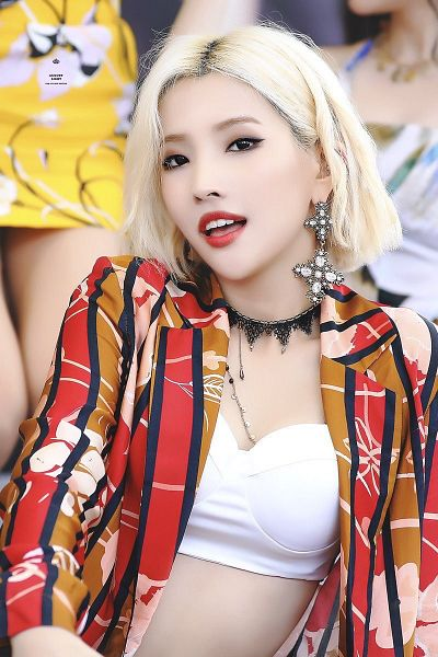 Tags: K-Pop, (G)-I-DLE, Jeon Soyeon, Red Lips, Blonde Hair, Red Outerwear, Make Up, Necklace, Striped Jacket, Black Eyes, Crop Top, Red Jacket