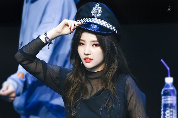 Tags: K-Pop, (G)-I-DLE, Jeon Soyeon, Nail Polish, Hand On Hat, Sitting On Chair, Straw, Bottle, Hat, Make Up, Bracelet, Looking Ahead