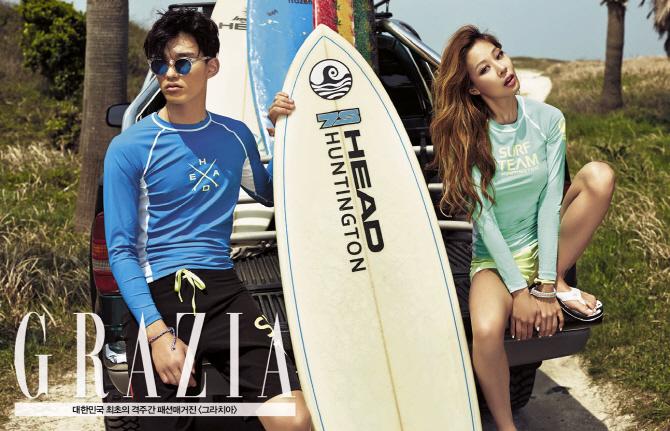 Tags: Lucky J, Jessi, Text: Magazine Name, Surfboard, Sandals, Green Shirt, Bare Legs, Grazia Korea