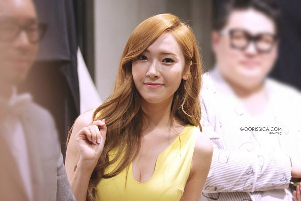 Tags: SM Town, K-Pop, Girls' Generation, Jessica Jung, Yellow Outfit, Yellow Dress, Wavy Hair, Bare Shoulders, Suggestive, Cleavage, Sleeveless Dress, Sleeveless