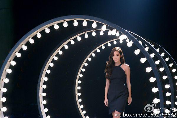 Tags: K-Pop, Girls' Generation, Jessica Jung, Bare Legs, Black Background, Bare Shoulders, Sleeveless, Sleeveless Dress, Looking Ahead, Walking, Foundation, Wavy Hair