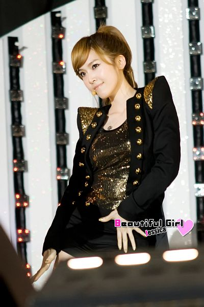 Tags: K-Pop, Girls' Generation, Jessica Jung, Hair Up, Black Shorts, Ponytail, Looking Ahead, Shorts, Gold Shirt, Black Jacket, Black Outerwear, Beautiful Girl