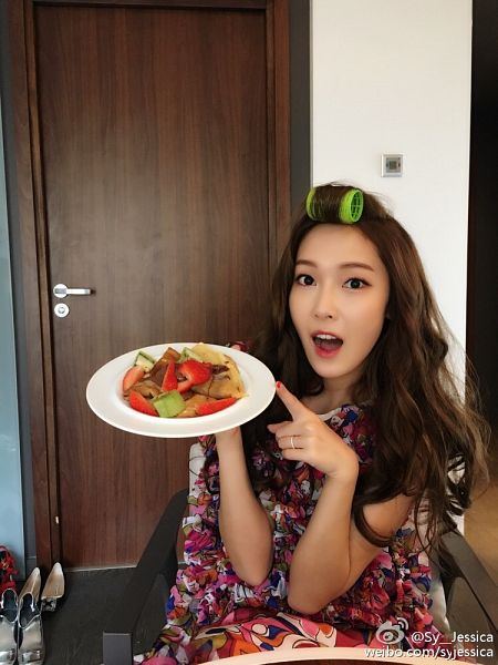 Tags: K-Pop, Jessica Jung, Wavy Hair, Make Up, White Dress, Chair, Sitting On Chair, Fruits, White Outfit, Strawberry, Pointing, Food