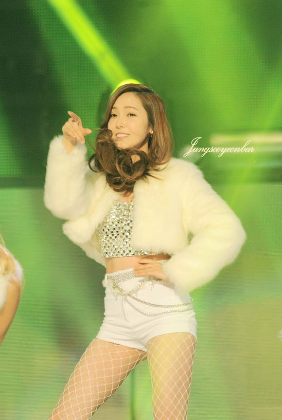 Tags: K-Pop, Girls' Generation, I Got A Boy, Jessica Jung, Wavy Hair, Green Background, Fishnets, Belt, White Jacket, Pointing, Bare Legs, Pantyhose