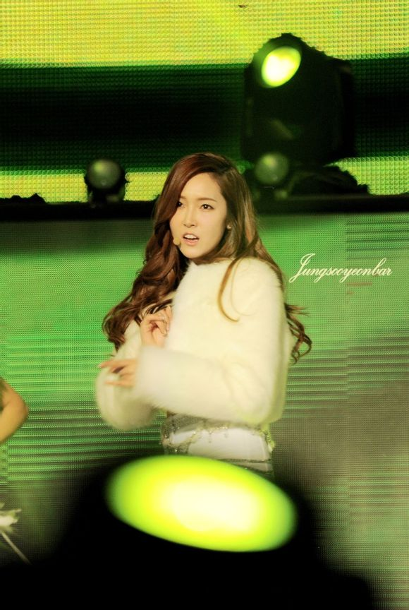 Tags: K-Pop, Girls' Generation, I Got A Boy, Jessica Jung, Green Background, Wavy Hair, Silver Shirt, White Jacket, Belt, White Outfit, White Shorts, White Outerwear
