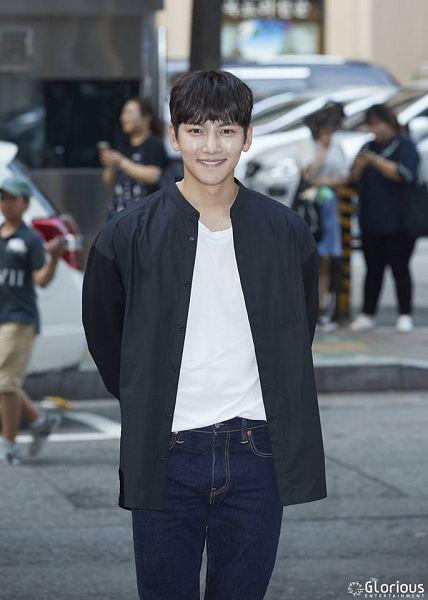 Tags: Glorious Entertainment, K-Drama, Ji Chang-wook, Black Shirt, Blunt Bangs, Text: Company Name, Jeans, Arms Behind Back