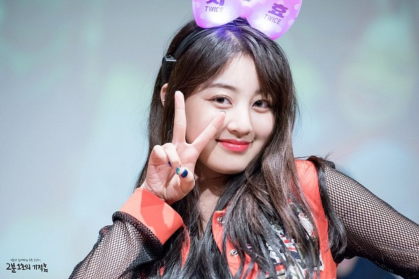 Tags: K-Pop, Twice, Jihyo, Text: Artist Name, Nail Polish, Red Outerwear, Bow, Gray Background, Pink Bow, Red Jacket, Hair Ornament, Hair Bow