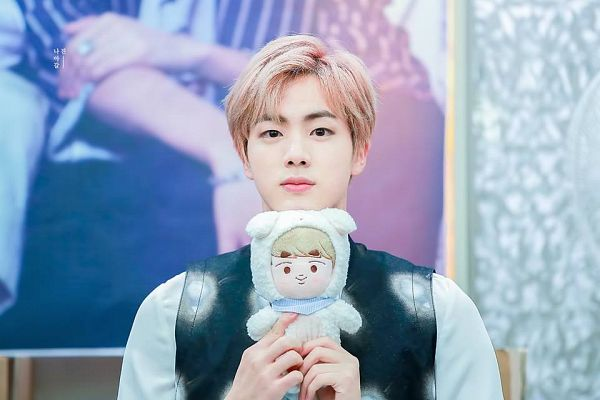 Tags: K-Pop, BTS, Jin, Serious, Stuffed Toy, Pink Hair, Black Outerwear, Vest, Black Eyes, Toy, Fansigning Event