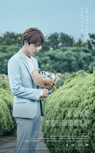 Tags: K-Pop, BTS, Jin, English Text, Bouquet, Korean Text, Blue Outerwear, Flower, Plant, Tree, Text: Company Name, Blue Jacket