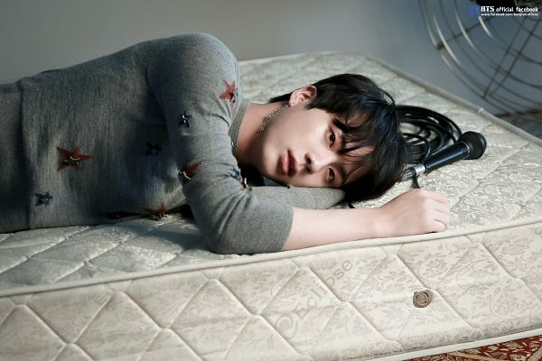 Tags: K-Pop, BTS, Jin, Laying Down, Looking Ahead, Laying On Side, Indoors, Sweater, Star (Symbol), Star Print, English Text, Text: URL