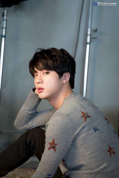 Tags: K-Pop, BTS, Jin, English Text, Text: URL, Star Print, Sweater, Star (Symbol), Black Pants, Indoors, Black Eyes, Facebook