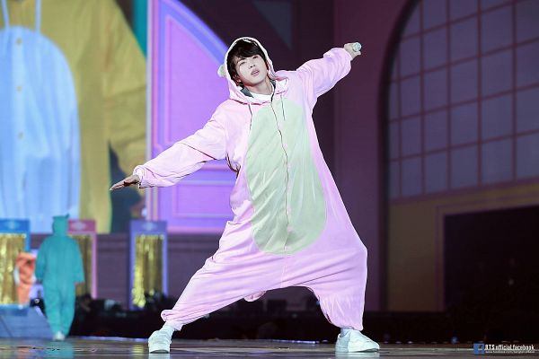 Tags: K-Pop, BTS, Jin, English Text, Arms Out, Duo, Animal Outfit, Black Eyes, Text: URL, Two Males, Stage, Text: Artist Name