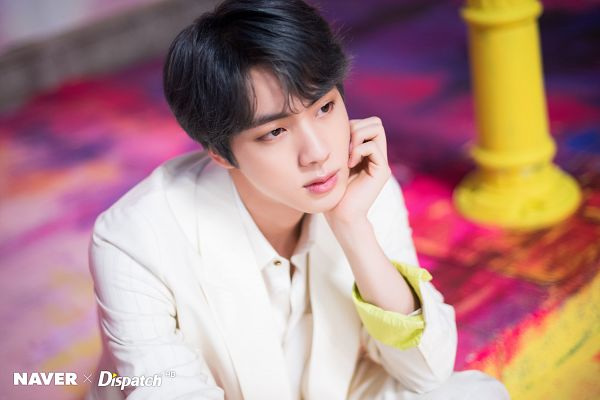 Tags: K-Pop, BTS, Boy With Luv, Jin, White Jacket, White Outerwear, Black Eyes, Serious, English Text, Arm Support, Dispatch, Map of the Soul: Persona