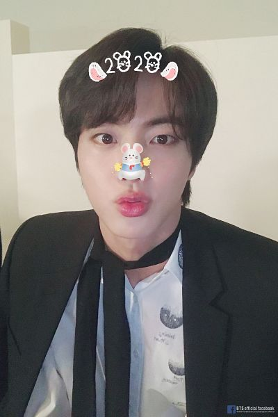 Tags: K-Pop, BTS, Jin, Text: URL, Black Neckwear, English Text, Pouting, Tie, Text: Artist Name, New Year, Animal Ears, Close Up