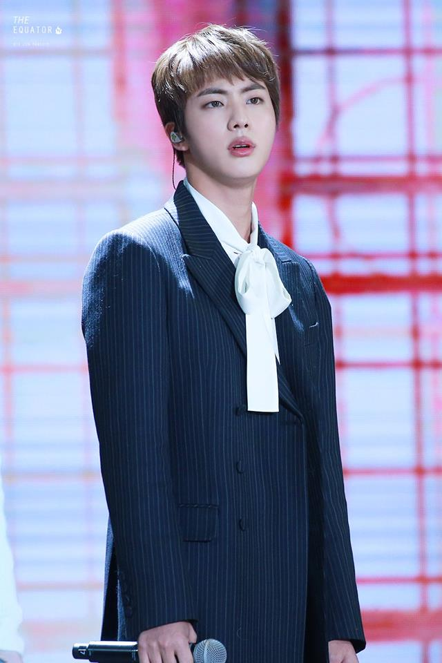 Tags: K-Pop, BTS, Jin, Gray Jacket, Earbuds, Stage, Gray Outerwear, Serious