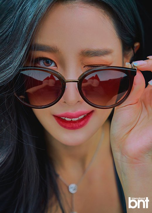 Tags: K-Pop, Berry Good, Johyun, Wink, Glasses, Sunglasses, Dark Background, Close Up, Necklace, Red Lips, Grin, Black Background
