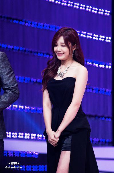 Tags: K-Pop, Apink, Jung Eun-ji, Necklace, Walking, Black Shorts, Black Outfit, Looking Down, Black Dress, Dress Slit, Blue Background, Shorts