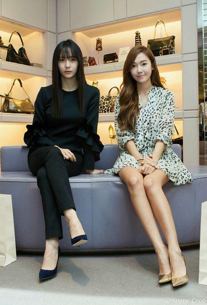 Tags: K-Pop, Jung Sisters, Jessica Jung, Krystal Jung, Blue Footwear, Black Pants, Gold Footwear, Spotted Dress, Couch, Duo, Ring, Black Footwear