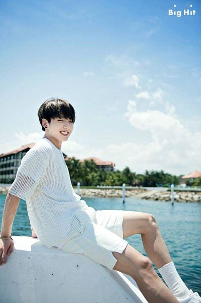 Tags: K-Pop, Bangtan Boys, Jungkook, Bracelet, White Shorts, Grin, Outdoors, Short Sleeves, Shorts, Clouds, Black Eyes, Sea