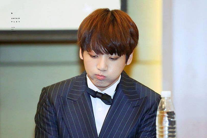 Tags: K-Pop, BTS, Jungkook, Black Jacket, Black Outerwear, Bottle, Bow Tie, Black Neckwear, Black Eyes, Suit, Striped, Pouting