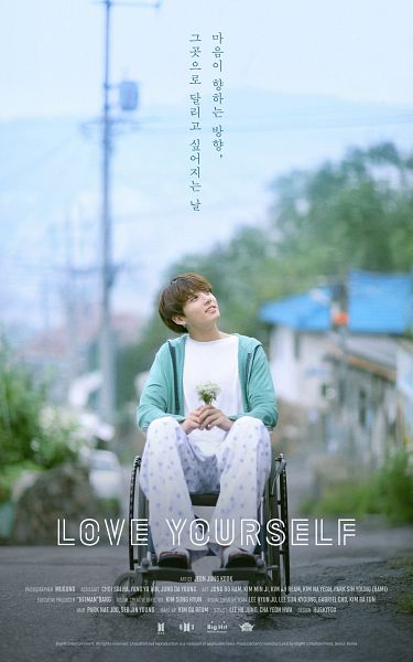 Tags: K-Pop, Bangtan Boys, Jungkook, Road, Sky, Full Body, Text: Artist Name, Chair, Looking Up, Wheelchair, Grin, Text: Album Name