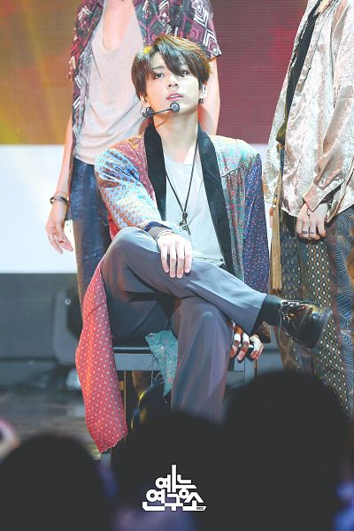 Tags: Television Show, K-Pop, Bangtan Boys, Airplane pt.2, Jungkook, Microphone, Korean Text, Sitting On Chair, Black Footwear, Bracelet, Hand On Leg, Shoes