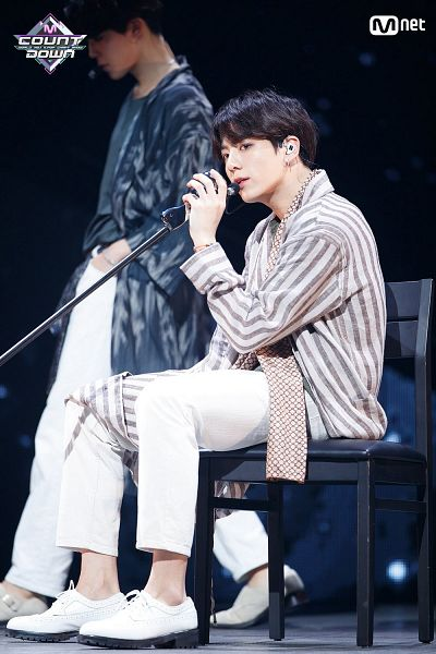 Tags: K-Pop, Television Show, BTS, Airplane pt.2, Jungkook, Park Jimin, Coat, Chair, Holding Object, Singing, White Pants, Sitting On Chair