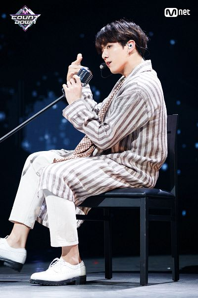Tags: Television Show, K-Pop, Bangtan Boys, Airplane pt.2, Jungkook, Dark Background, Sitting On Chair, Singing, Shoes, Striped, Coat, Holding Object