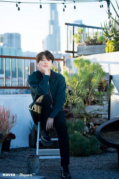 Tags: K-Pop, Bangtan Boys, Jungkook, Plant, Shoes, Green Shirt, City, Striped, Tie, Sky, Outdoors, Black Pants