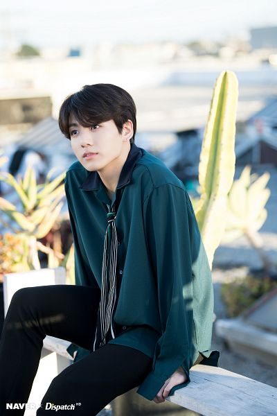 Tags: K-Pop, BTS, Jungkook, Green Shirt, Day, Plant, Sky, Outdoors, Black Pants, Striped, Collar (Clothes), Cactus
