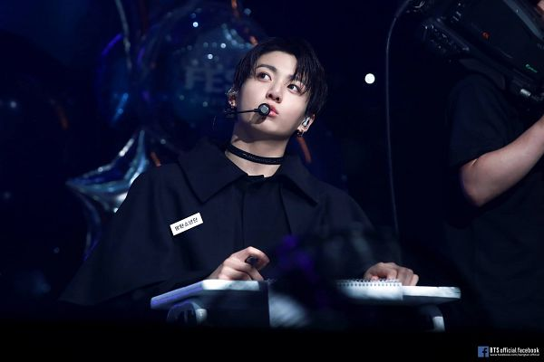 Tags: K-Pop, Bangtan Boys, Jungkook, Looking Away, Text: URL, Choker, Microphone, Duo, Capelet, Black Outfit, Table, Collar (Clothes)
