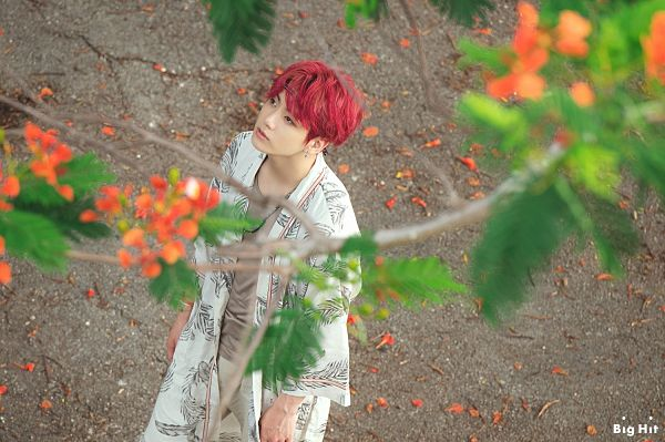 Tags: K-Pop, BTS, Jungkook, Red Hair, From Above, Bracelet, Brown Shirt, Outdoors, English Text, Leaf, Looking Up, Necklace