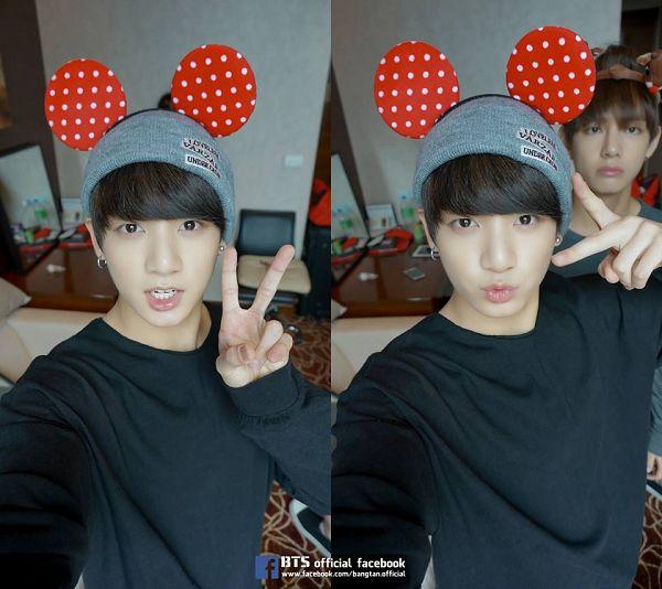 Tags: K-Pop, Bangtan Boys, Jungkook, Earrings, Gray Headwear, Black Shirt, Animal Ears, V Gesture, Selca