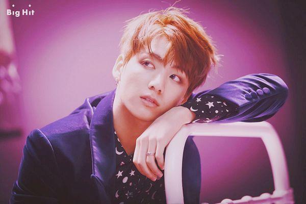 Tags: K-Pop, Bangtan Boys, Blood Sweat & Tears, Jungkook, Chair, Ring, Looking Away, Purple Background, Jacket, Red Hair, Wings (Album)