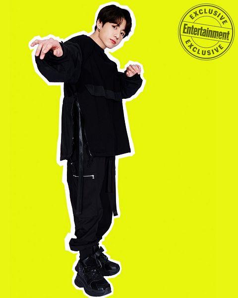 Tags: K-Pop, Bangtan Boys, Jungkook, English Text, Black Shirt, Full Body, Black Footwear, Yellow Background, Black Pants, Entertainment Weekly, Magazine Scan