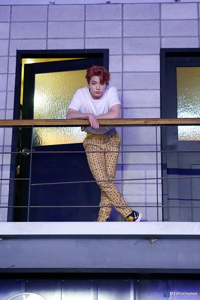 Tags: K-Pop, BTS, IDOL (Song), Jungkook, Yellow Pants, English Text, Fence, Text: URL, Short Sleeves, Red Hair, Text: Artist Name, Love Yourself: Answer